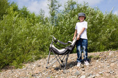Boy with a chair Stock Images
