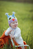 Boy on a chair in a field. Royalty Free Stock Photos
