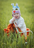 Boy on a chair in a field. Stock Photo