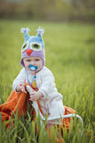 Boy on a chair in a field. Royalty Free Stock Images