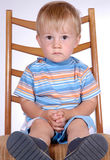 Boy on chair III. Portrait of a little boy Royalty Free Stock Photos