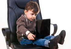 Boy on chair Stock Images