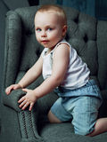 Boy in the chair Royalty Free Stock Image