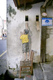 Boy on chair Street Art Mural in Georgetown, Penang, Malaysia Stock Images