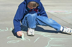 Boy with Chalk Royalty Free Stock Image