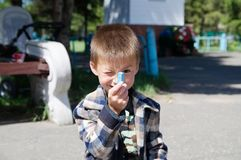 Boy with chalk winking going to paint crayons Stock Photos