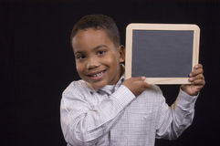 Boy with chalkboard. Cute kid with chalkboard sign - make your own Royalty Free Stock Images