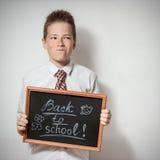 Boy with chalkboard - back to school Stock Image