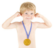 Boy champion with golden medal. Hands raised up. Over white Royalty Free Stock Photos