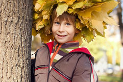 Boy with chaplet of yellow maple leaves Royalty Free Stock Photography