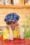 Boy in checkered blue cap Stock Image