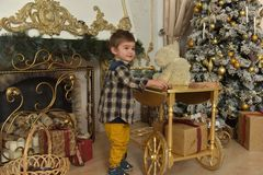 Boy in checkered shirt at christmas. Plays stock photo
