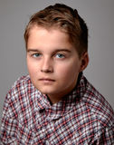 Boy in checkered shirt Stock Photography