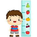 Boy checking height Royalty Free Stock Image