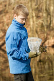 Boy checking his catch in fishing net Royalty Free Stock Images