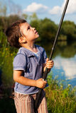 Boy checking rod Royalty Free Stock Photos