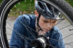 Free Boy Checks His Bicycle Chain Royalty Free Stock Photos - 175073418