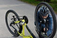 Boy checks his bike Stock Photography