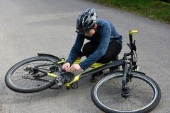 Boy checks his bike. Teenage boy checking his bike Stock Photography