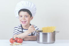 Boy chef. Cooking Italian pasta Stock Photography