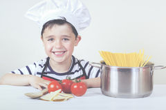 Boy chef. Cooking Italian pasta Royalty Free Stock Image