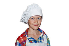 Boy chef. Cute boy chef in apron and cap.isolated on white background Royalty Free Stock Images