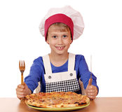 Boy chef eat pizza Royalty Free Stock Image