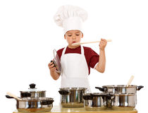 Boy in chef hat playing Stock Image