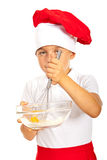 Boy chef mixing egg with flour Stock Photography