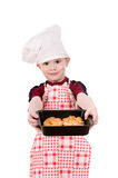 Boy in chef's hat with baking Stock Photography