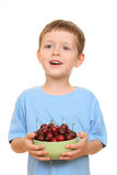 Boy and cherries Royalty Free Stock Photos