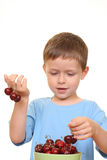 Boy and cherries Royalty Free Stock Image
