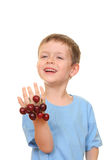 Boy and cherries Stock Images