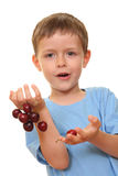 Boy and cherries Stock Image