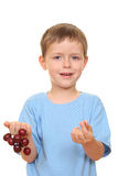 Boy and cherries Royalty Free Stock Photography