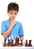 A boy and a chess. A boy thinking of next move playing chess isolated on a white background Stock Photo