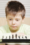 Boy and chess Royalty Free Stock Photography