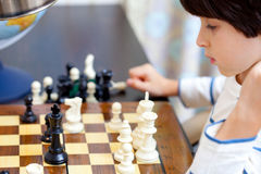 Boy and chess Royalty Free Stock Photo