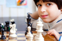 Boy and chess, close-up Royalty Free Stock Images