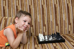Boy with chess Stock Image