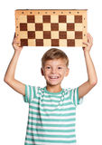 Boy with chessboard Royalty Free Stock Photo