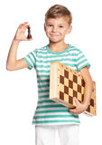 Boy with chessboard Royalty Free Stock Image