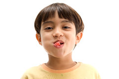 Boy chewing gum. Portrait of Boy chewing gum and showing Stock Photos