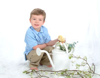Boy and Chick with Water Can Stock Images