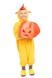 Boy in the chicken costume with pumpkin Royalty Free Stock Photography