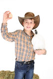 Boy with chicken and egg. Farm boy with a small bantam and a chicken egg royalty free stock photography