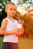 Boy Child caucasian drinking Juice Beverage plastic bottle Royalty Free Stock Photography