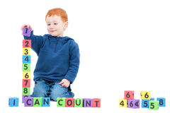 Boy child counting numbers with kids blocks
