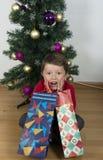 Boy child happy. Boy child happy over christmas tree Royalty Free Stock Image