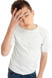 Boy child, headache, tired, weary. A boy with hand on forehead, headache, pain, tired, weary, depression royalty free stock image